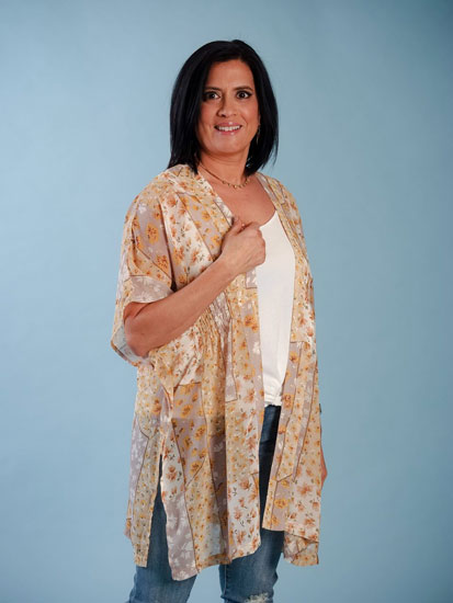 A woman models a cute Mother's Day outfit idea including jeans and a kimono.