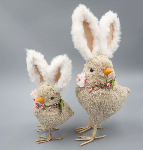 Two rustic straw chick figurines with large rabbit ears.