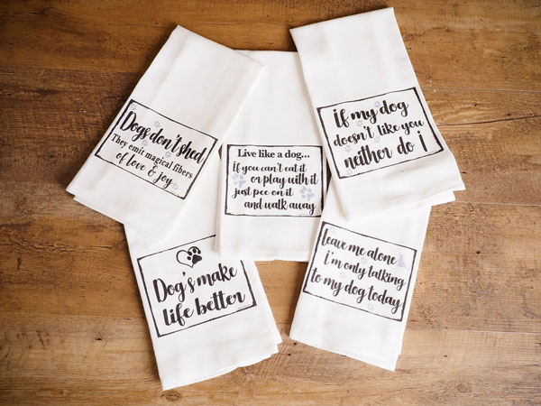 A collection of tea towels with cute slogans as an example of popular home decor trends in 2020.
