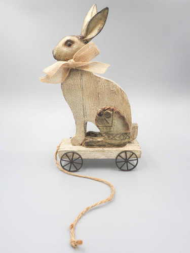 Vintage, wooden rabbit rustic Easter decor pull toy.