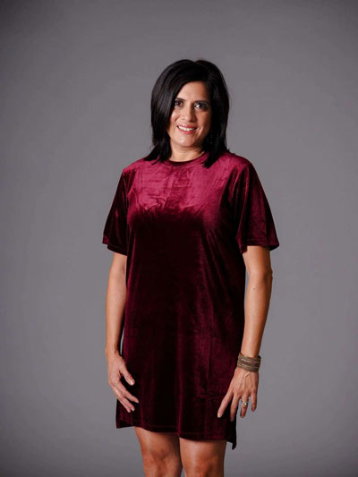 A woman models a red velvet short sleeve casual boutique dress